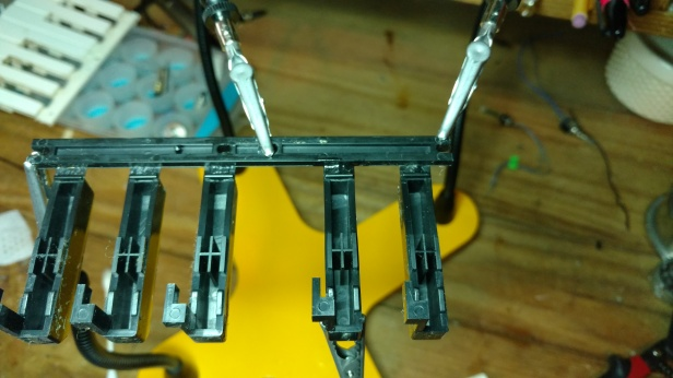 the offending black key needed to be re-glued to it's plastic bank. Good thing I have a set of (4) spare hands !